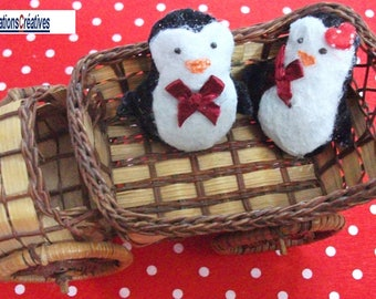 Couple of penguins. Red Christmas decoration or toy