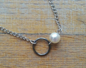Simple gunmetal ring and pearl necklace