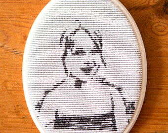 Embroidered framed portret