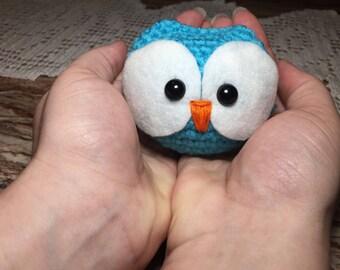 Blue big eyed bird