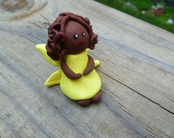 Mini Fairy in Yellow with Dark Skin and Brown Hair in Medium Curly Style