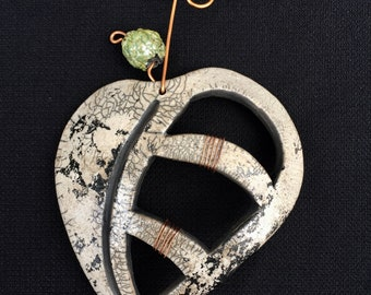Raku Leaf wall hanging with cut outs and green bead