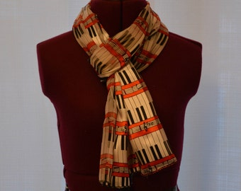 Red, White, and Black Piano Keys with Music Notes Scarf
