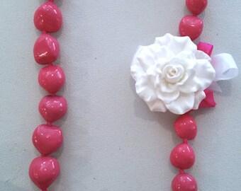 Gardenia lei with kukui nuts/ dark pink