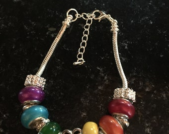 Handmade beaded bracelet in LGBT pride colors with heart charm