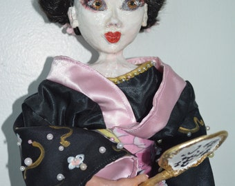 Hand made clay doll