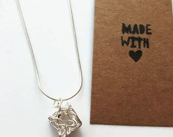 Wire wrapped cube necklace
