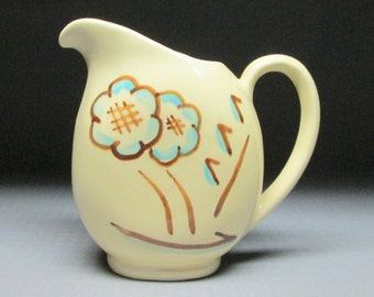 SHAWNEE pottery pitcher with flowers marked USA 35