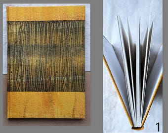 Handmade binding covered with colored paper. Travelog, writing book or sketchbook. Pad of sketch