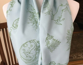 Game of Thrones infinity scarf, sigils of Westeros. Light blue with green sigils.
