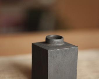 Black ceramic tea container