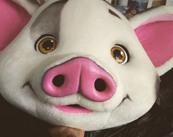 The head of a pig. Mask of a pig. Fursuit pigs.
