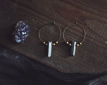 silver crystals. a pair of titanium crystal spike and golden African beaded hoop earrings