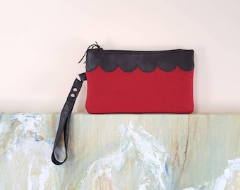 Recycled black leather and red scallop zipper wristlet