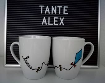 Handmade and painted mug with kite and own, personal name