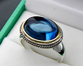 AAAA Natural London Blue Topaz Cabochon   14x10mm  6.5 Carats   in 18K Yellow gold and Sterling silver or 14K gold ring.  0828 y
