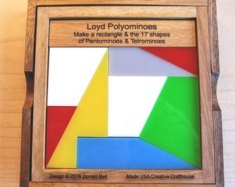 Loyd Polyominoes – 2018 design. Eight pieces make the rectangle plus all 17 shapes from Pentominoes and Tetrominoes.