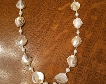 Genuine ammoninite pendant hand strung on necklace with shells and freshwater pearls
