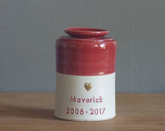 custom urn with ceramic lid, straight shaped urn. modern simple urn for ashes. candy red on porcelain clay urn with gold heart shown.