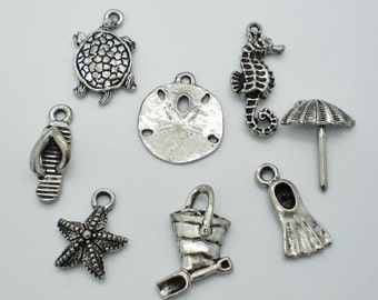 Antiqued Pewter Sand & Sea Charms - Set of 8
