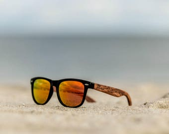 Polarized sustainable wooden wayfarer style red lens sunglasses with a strong polycarbonate frame and UV400 protection