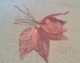 Vintage pink satin embossed leaves