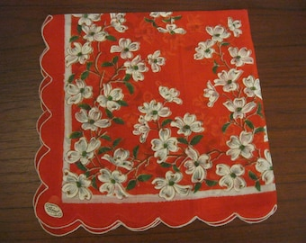 Red handkerchief with white dogwood motif and scalloped edge by Burmel