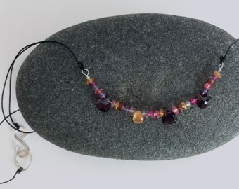 red garnets, sapphire, pink topaz, amethyst and rubies on black silk beaded necklace
