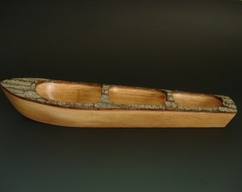B.O.T.E. hand carved wooden boat