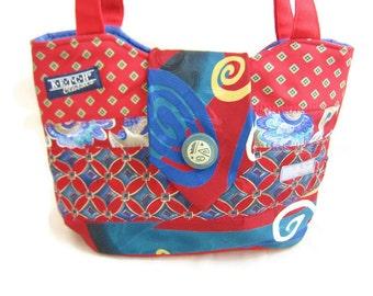 Handmade Necktie Handbag with Eye Catching Swirls