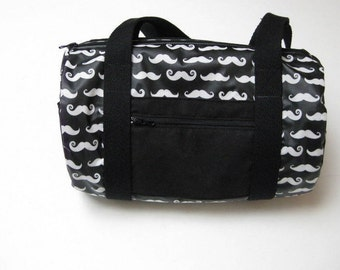 Mini duffel bag in black waterproof coated cotton with mustaches