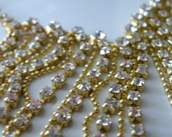 Waterfall, Cascade, dangle necklace. Gold plate metal, clear rhinestones.