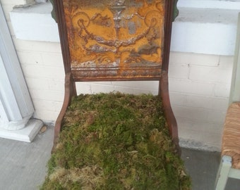 Wonderful, unique re-purposed antique chair with moss cushion seat and rusted tin ceiling tile back, very unusual, great conversation piece