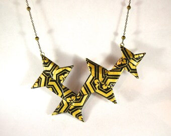 Origami sakura flower star Shuriken necklace.