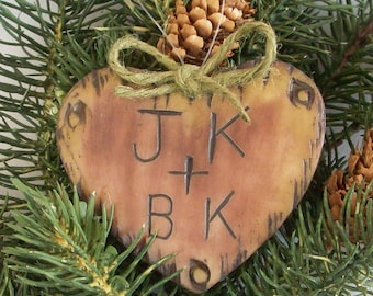 Ornament with carved intitial in a wood look heart