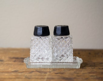 3pc Pressed Glass Salt and Pepper Shakers from Japan with Dish, Black Bakelite Catalin lids, Glass Tray, Vintage Dining Room Decor