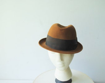 Classy vintage 50s, light brown felted , fedora , hight crown hat with a feather. Made by Champ.Size 6 7/8