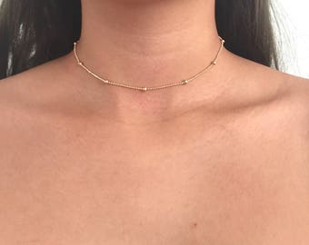 Tiny ball satellite choker