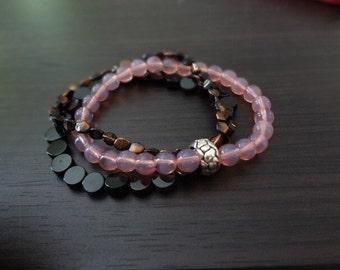 handmade pink, black, and copper stretch bracelet trio