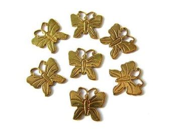 7 Butterfly shape vintage metal findings, metal stamping  can be beads and pendants