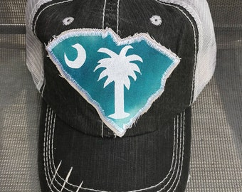 Black distressed trucker hat with South Carolina state