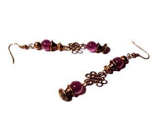Vintage pair of purple and bronze earrings
