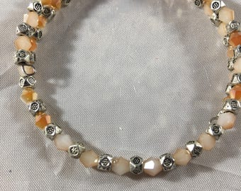 Peach and silver beaded bracelet