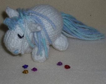 Sleepy knitted unicorn soft toy