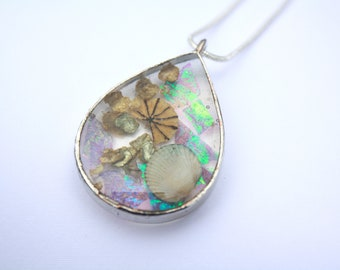 shell poppy seed and rainbow pieces interesting eye catching necklace by dead good jewellery