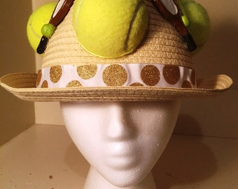 Tennis hat with tennis balls and racquets