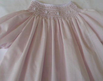 Hand smocked bishop style dress in soft pink
