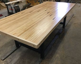 Dining table from reclaimed bowling lane Order Corley / Brian Deposit