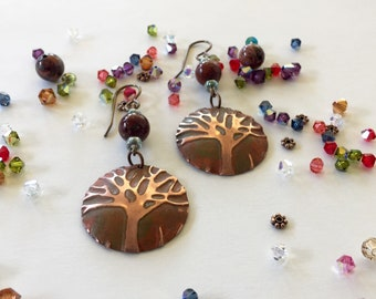 Earrings: Tree of Life with earth toned patina + transparent blue + red jasper beads