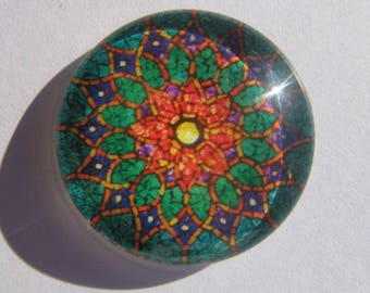 Glass cabochon round 25 mm with the image with a brown yellow green geometric pattern